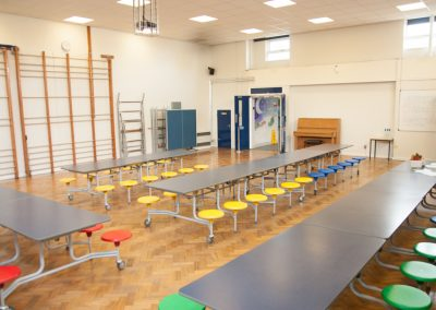 Lower school hall with access to tables and chairs